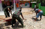 Balai Desa Dasuk Laok di Gruduk Satgas TMMD Giat Karya Bakti ke-110 Kodim 0827 Sumenep.